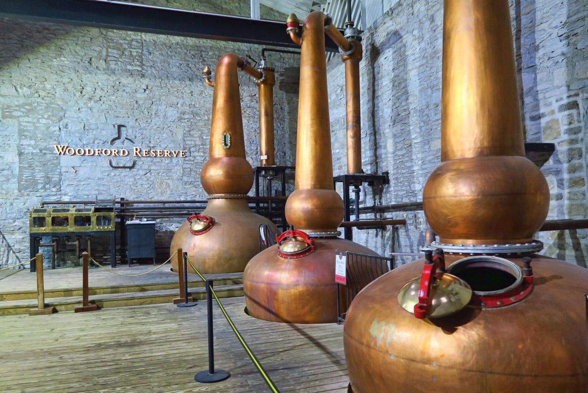 Woodford Reserve differentiates itself by distilling in three copper pot stills, whereas others use only a two-step process.