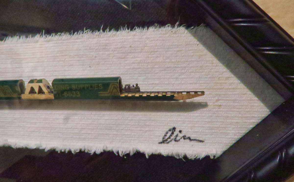 "In addition to over 500 houses and roomboxes, the museum has a temporary exhibit going on. ""On Point: Sculptures on the Tips of Lead Pencils"" This one, a train and trestle carved from a carpenter's pencil."