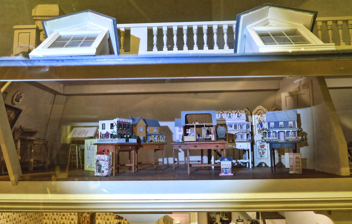 I loved having the flashlight so I could see what was in the attic. Note the doll house workshop in the attic of the doll house!