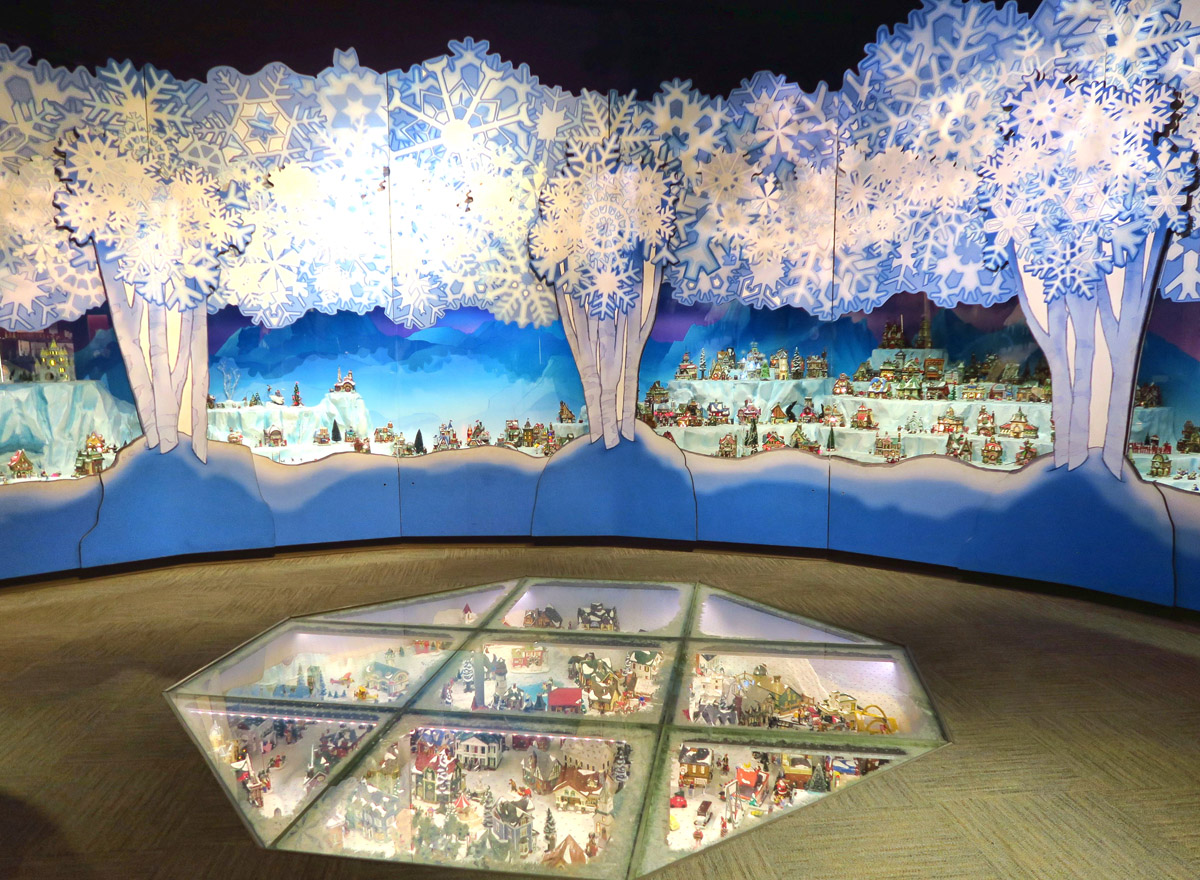 "Final room of the museum is the ""Enchanted Realm."" There is a giant four-season tree with mouse houses and fairies. Here is Santa's Village recessed into the walls, and in the sunken floor display."