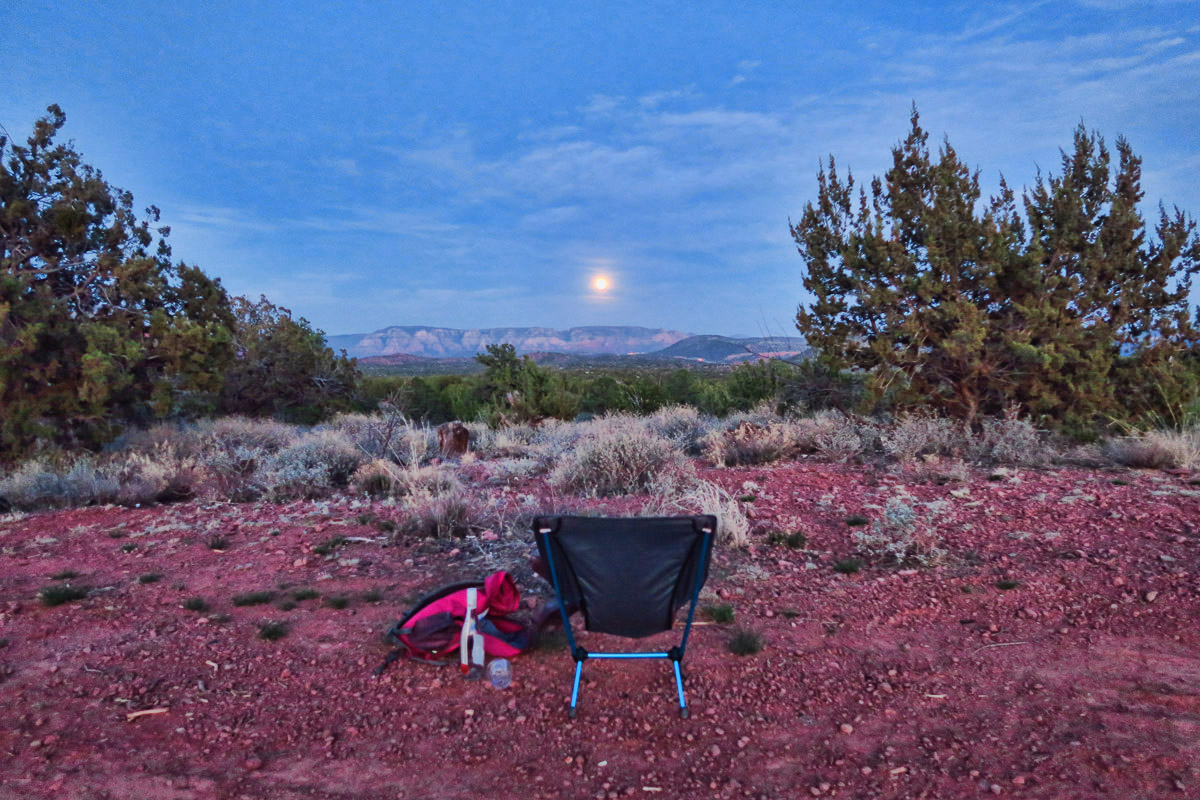 On the night of the full moon, I pack my backpack with camp chair, blanket, and a bottle of wine and hike down a closed OHV road to watch the moon rise far from Generator Circle.