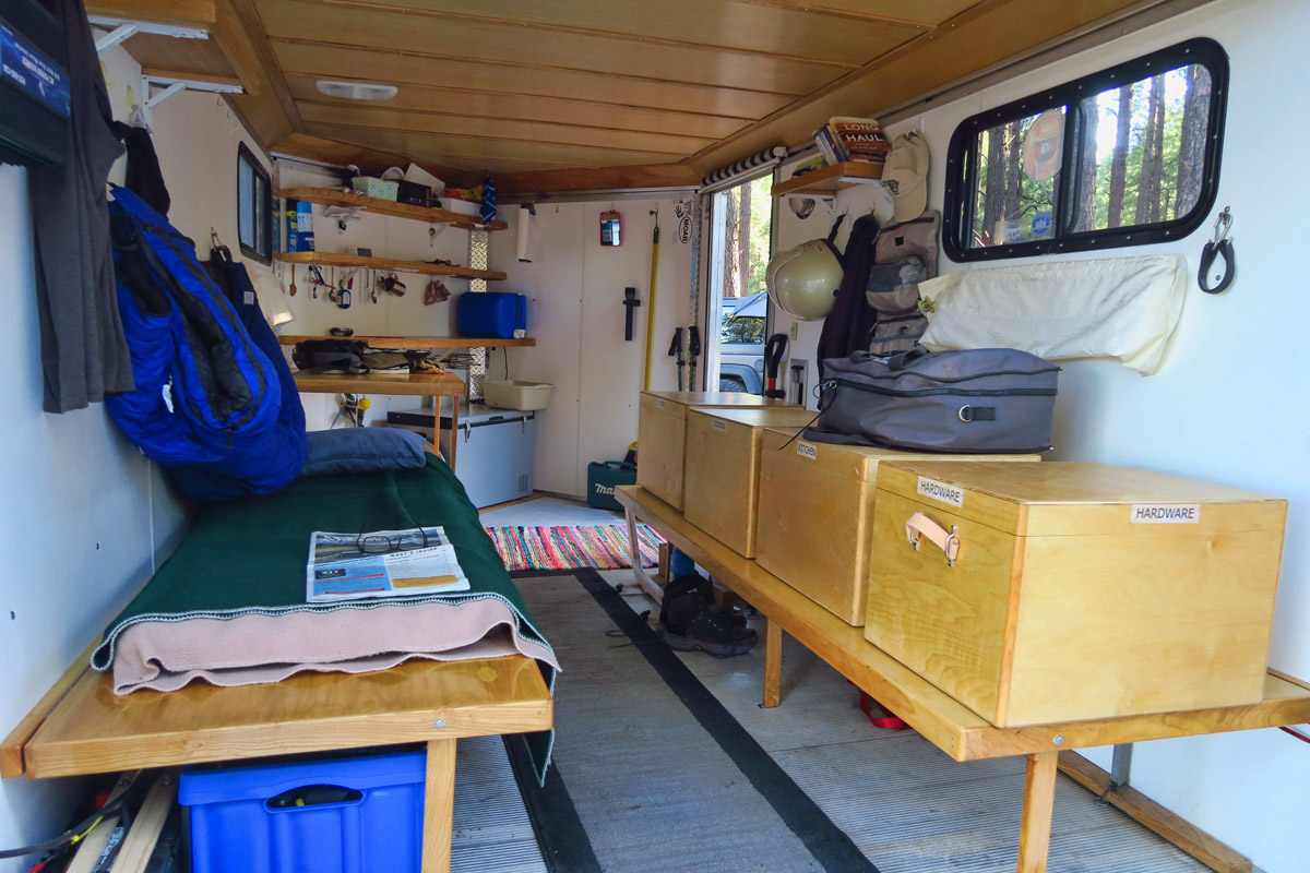"This is another neighbor Dean's motorcycle trailer. I think he's done a nice job with ""fit and finish!"" Note nice paneling on ceiling. Very cozy! Motorcycle rides in the middle."