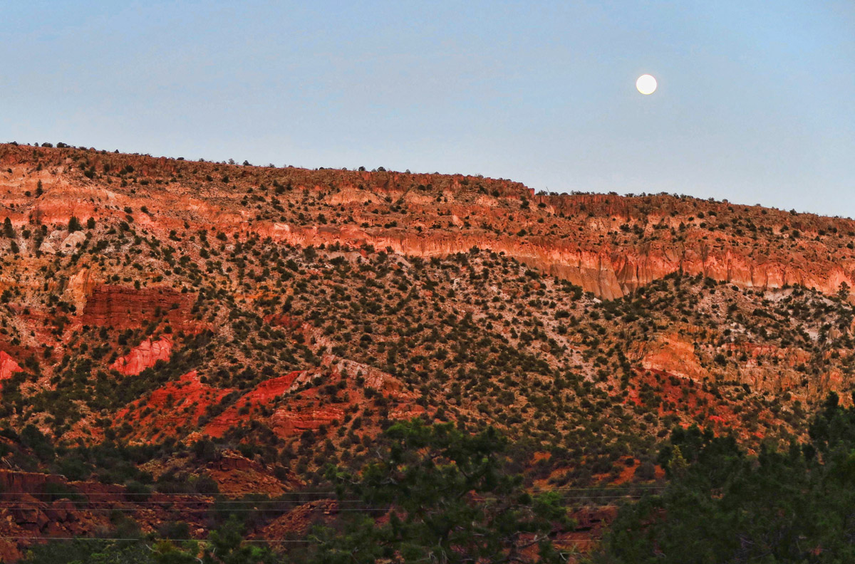 Full moon rising over the mesa.