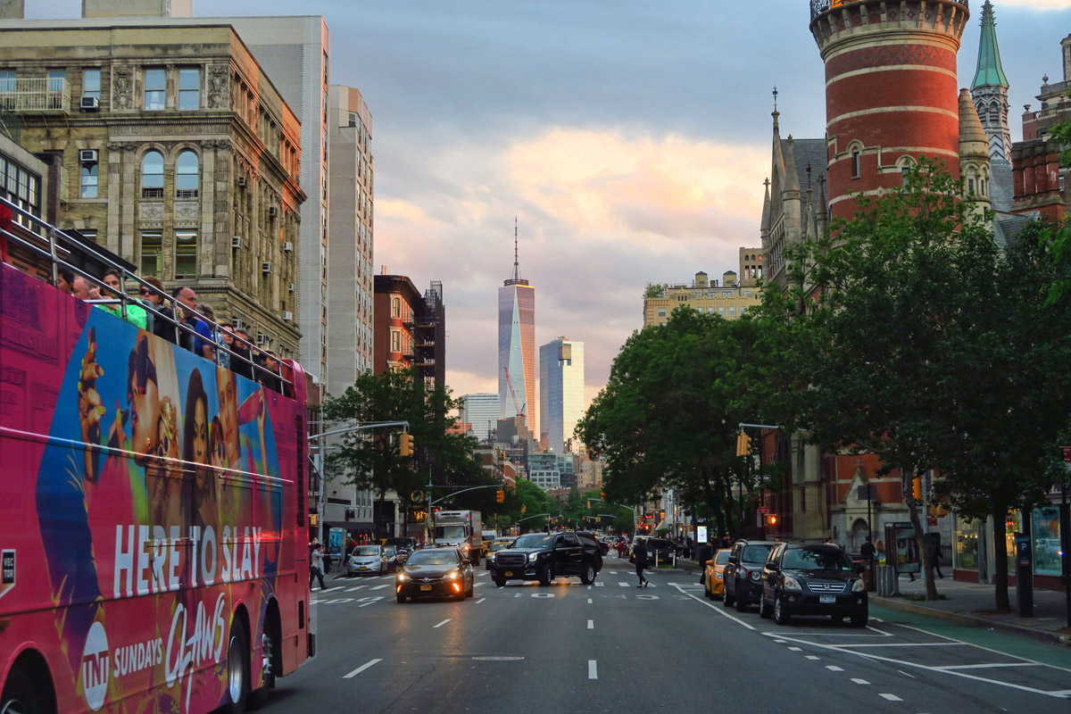 Sunset across Sixth Avenue, reflecting on the walls of the new Freedom Tower.