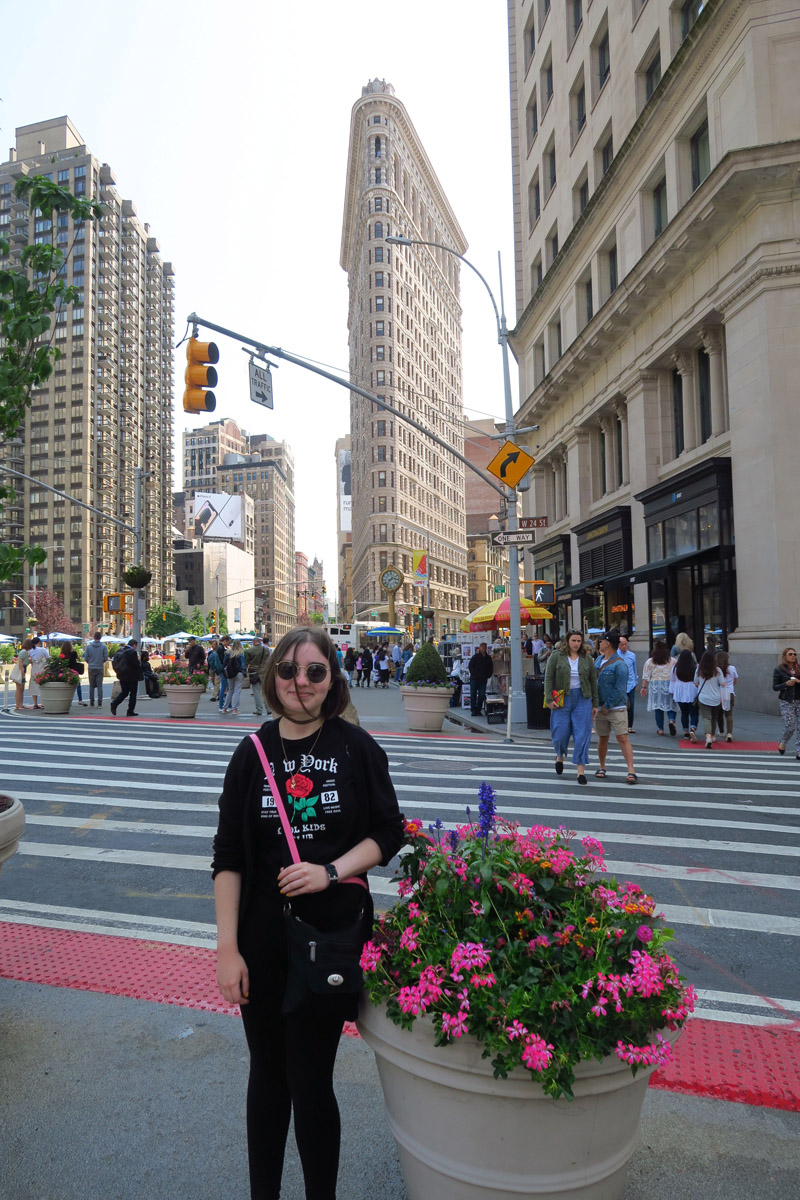 My iconic niece in front of NY's iconic landmark, the Flatiron Building.