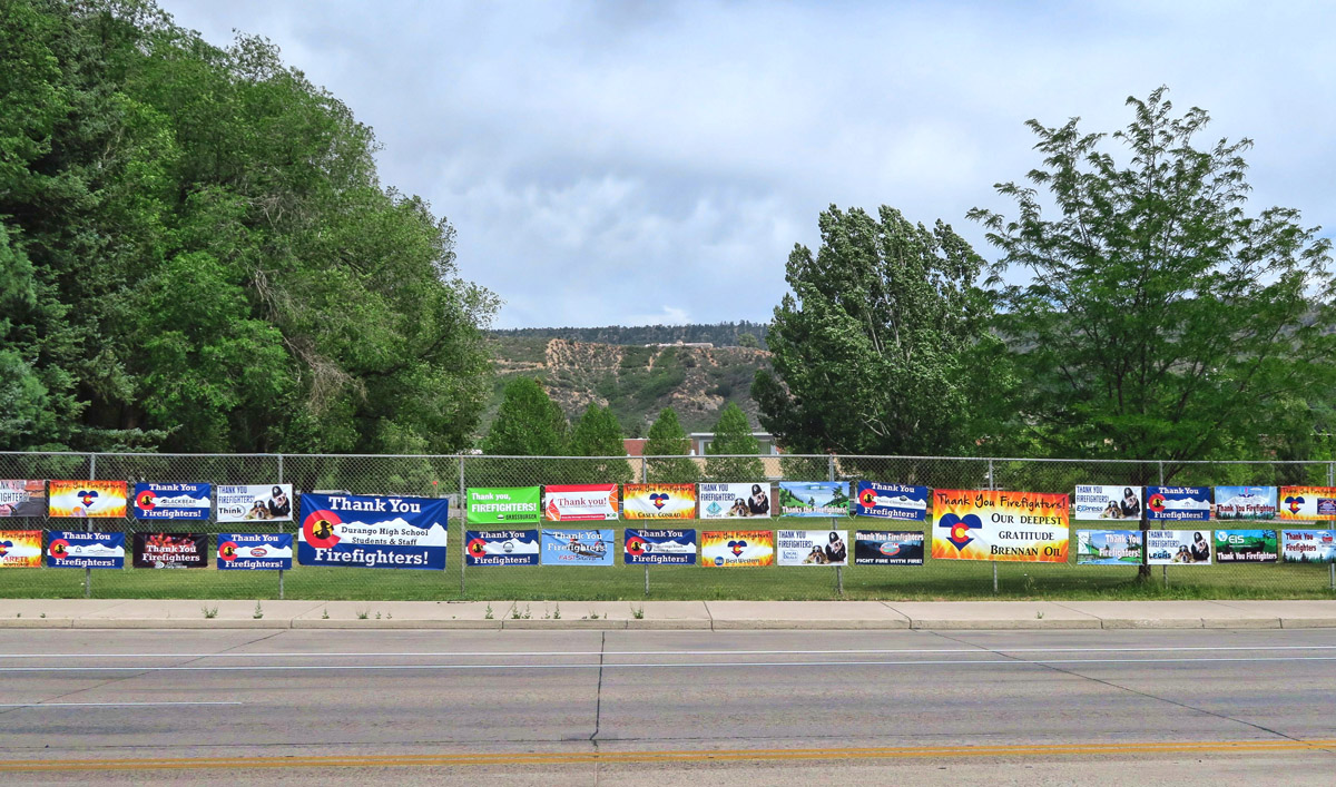 Signs line the fences and appear in front of all retail outlets thanking the firefighters for their service, stopping the 416 fire from closing in on Durango.